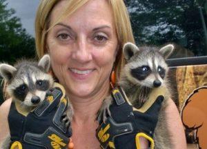 Girl holding raccoons