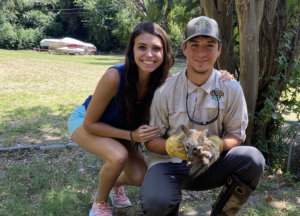 Christian and Victoria holding young fox