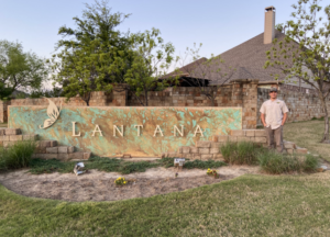 Lantana sign with a smiling AAAC Wildlife Removal specialist