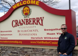 Man in front of Cranberry landmark