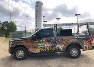 Wildlife Removal truck in front of Windcrest silo