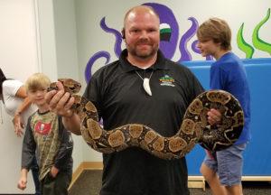 A man holding a snake
