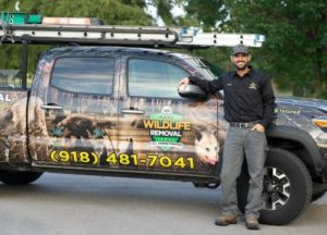 Owner, Kenneth Arbuckle leaning on AAAC Wildlife truck