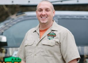 Owner, Sage Williams, smiling