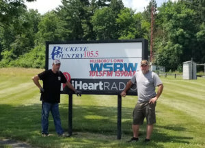 Travis and Dean in front of WSRW sign