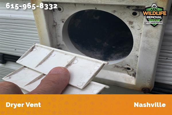 man inspecting a dryer vent in Nashville